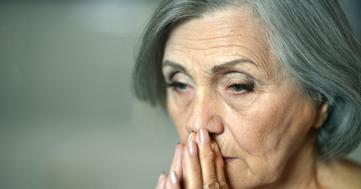 Older woman looking worried