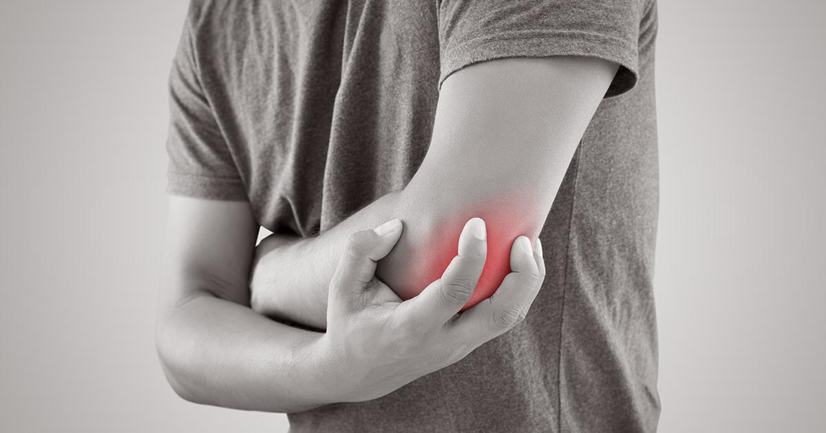 Man holding his elbow in pain