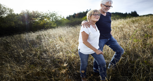 Two people going for a walk together through a field